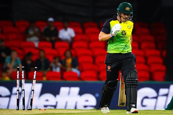 Finch walks back after being bowled in the one-off T20I against South Africa | Getty