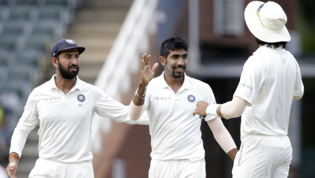 Bumrah with Pujara and Ishant Sharma | AFP