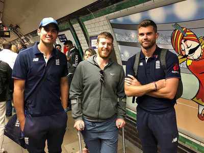Alastair Cook and James Anderson wait for the train with Ploughmans CC's crutch-bound opener Adam Barraclough | Twitter