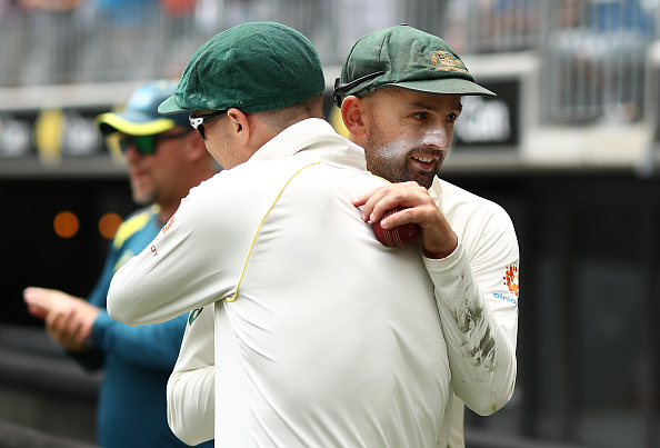Nathan Lyon gets a hug from Peter Siddle after picking a fifer against India | Getty