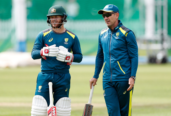 Warner and Langer during practice | Getty Images