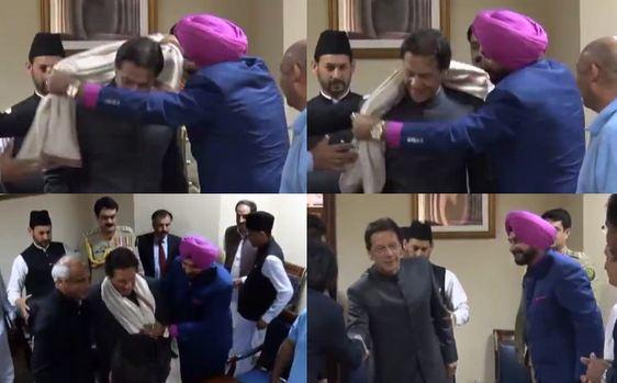 Navjot Singh Sidhu gifting a shawl to Pakistan's new PM Imran Khan