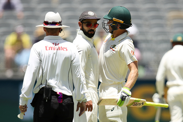 Kohli and Paine almost came close to chest bumping during Day 4 of the ongoing Perth Test | Getty