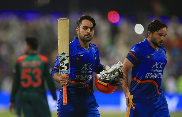 Rashid scored 57 off just 32 balls and helped take Afghanistan to the very competitive 255-7. | Getty