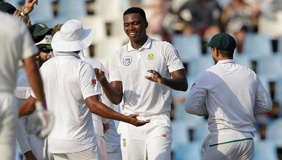 Lungi Ngidi celebrates his maiden Test wicket of Parthiv Patel with his teammates | AFP