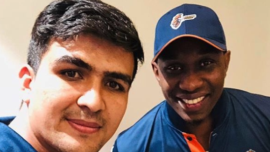 Dwayne Bravo keeps his promise by gifting his bat to Afghan special talent Hazratullah