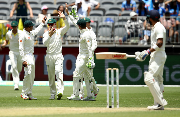 Handscomb celebrates after collecting a catch in the slips to dismiss Virat Kohli on Day 3 in Perth | Getty