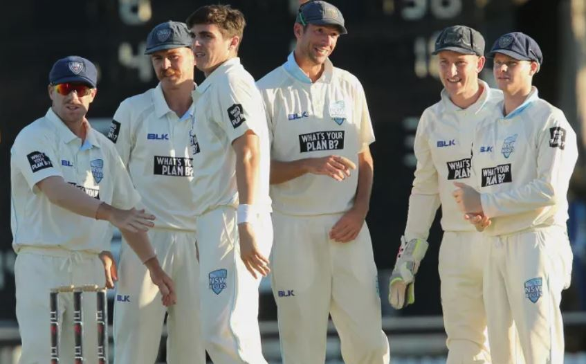David Warner and Steve Smith with NSW teammates | the Sydney Morning Herald