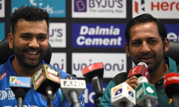 Rohit Sharma and Sarfaraz Ahmed at a press conference in Dubai | Getty Images