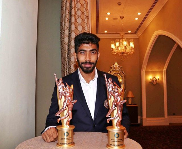Bumrah poses with the trophies | Instagram