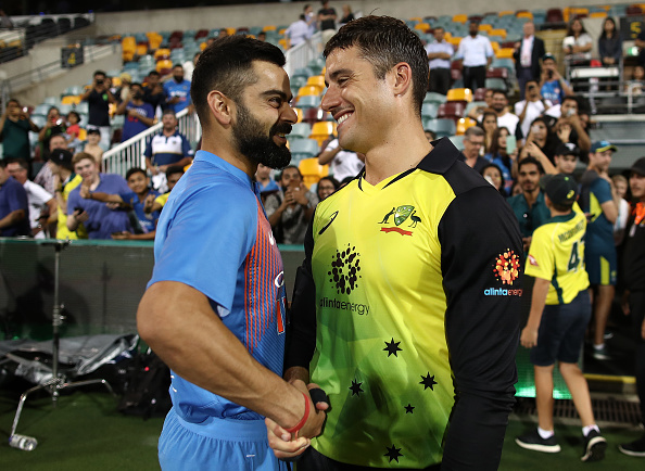 Virat Kohli's shaking hands with Marcus Stoinis in Brisbane | Getty Images