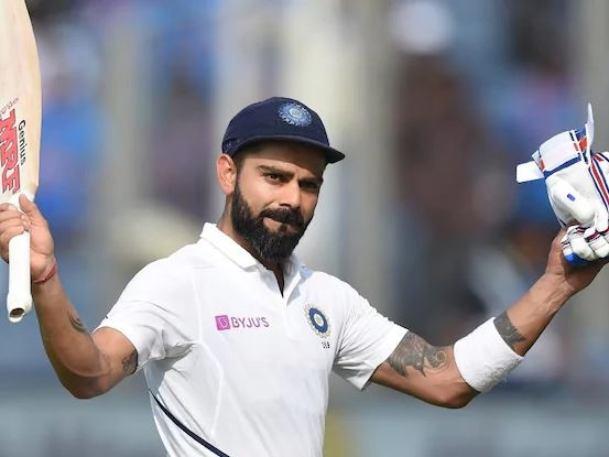 Virat Kohli celebrates his epic double ton in Pune Test | AFP