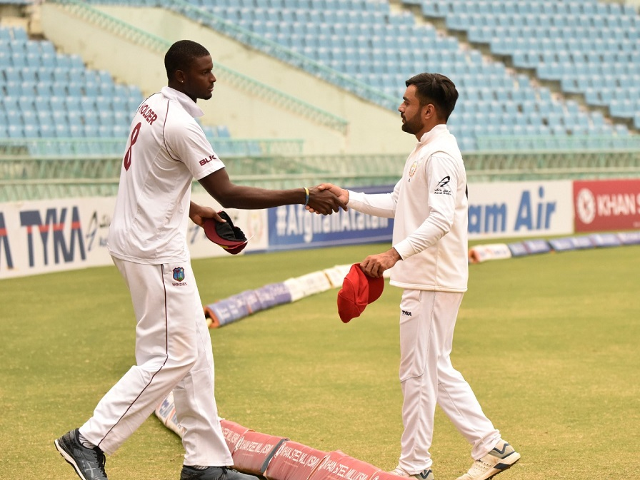 Captains Jason Holder and Rashid Khan shake hands after West Indies won the Test by 9 wickets | Twitter