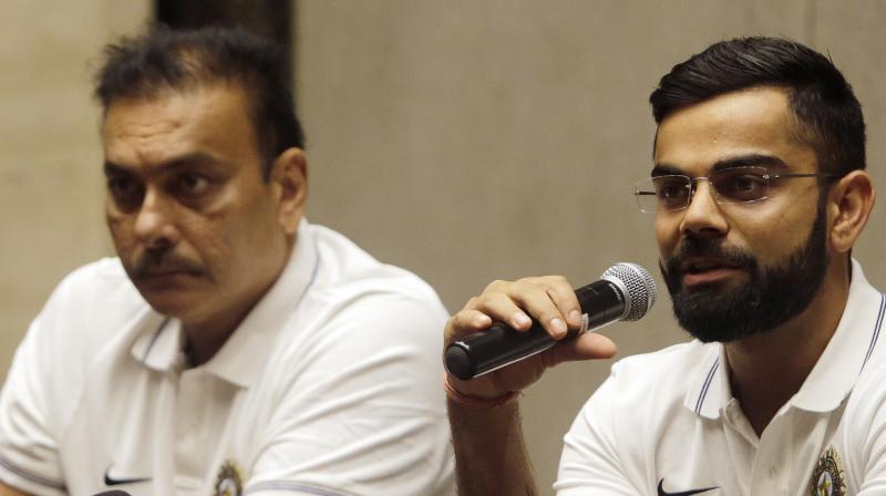 Virat Kohli and Ravi Shastri believe India has what it takes to win in England. (AP)