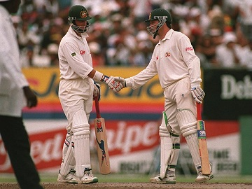 Steve and Mark Waugh congratulate each other