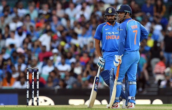 Rohit and Dhoni during their 141-run partnership in the first ODI against Australia at SCG | Getty