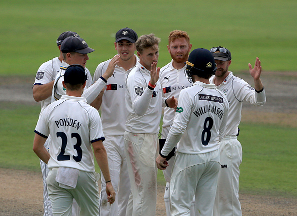 Joe Root (C) of Yorkshire celebrates after he takes the wicket of Jos Buttler of Lancashire | GETTY