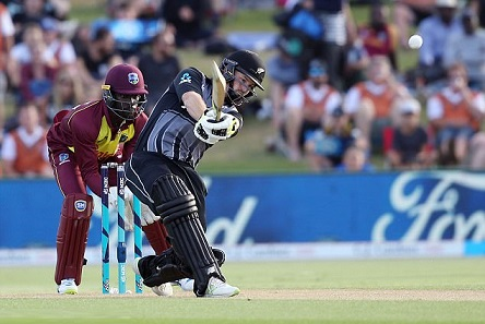 Colin Munro reaching his record third T20I hundred in 47 balls | AFP