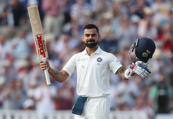 Virat Kohli celebrates his first century in England against the hosts | Getty