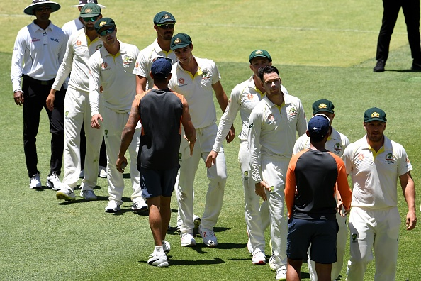 The two teams shakes hands, as Australia defeated India by 146 runs | Getty