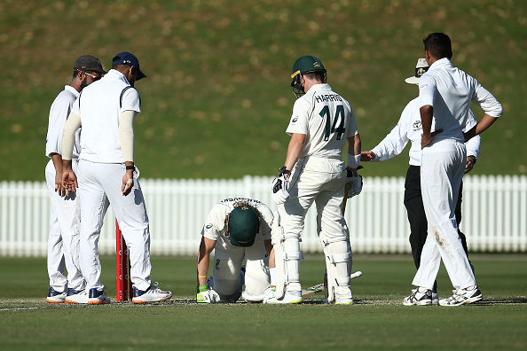 Australia's Will Pucovski fell to his knees after getting hit by a bouncer | Getty