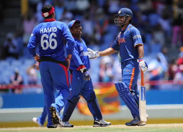 Mohammad Shahzad with MS Dhoni | GETTY