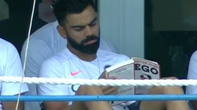 WI v IND 2019: Virat Kohli spotted reading 'Detox Your Ego', Twitter asks who convinced him to read it?