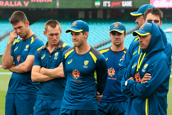 Tim Paine and his Australian teammates look dejected after losing the Test series to India | Getty
