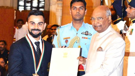 Virat Kohli reacts after being bestowed with the prestigious Khel Ratna award