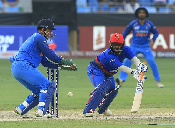 Mohammad Shahzad and MS Dhoni | GETTY