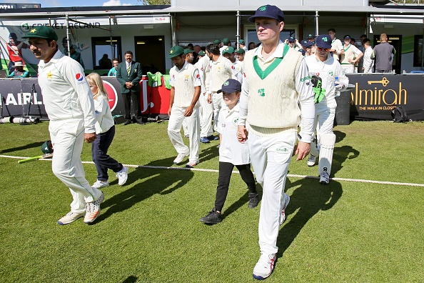 Willaim Porterfiled leads the Ireland team out in their first ever Test match | Getty
