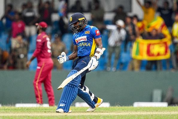 Wanindu Hasaranga celebrates after guiding Sri Lanka over the line | Getty