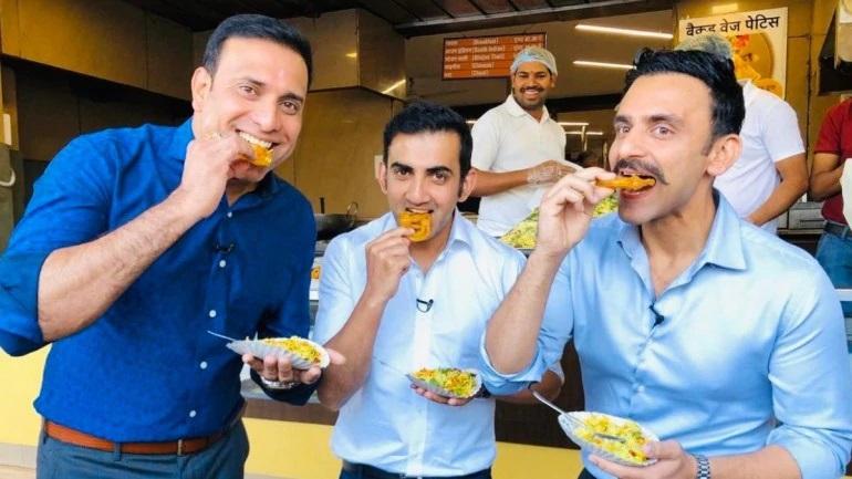 Gautam Gambhir eating jalebis with VVS Laxman
