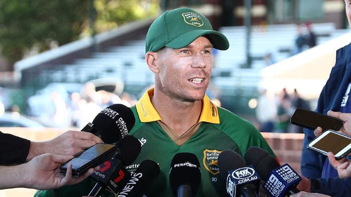 David Warner talking to media during a grade cricket match against Steve Smith's team | Getty