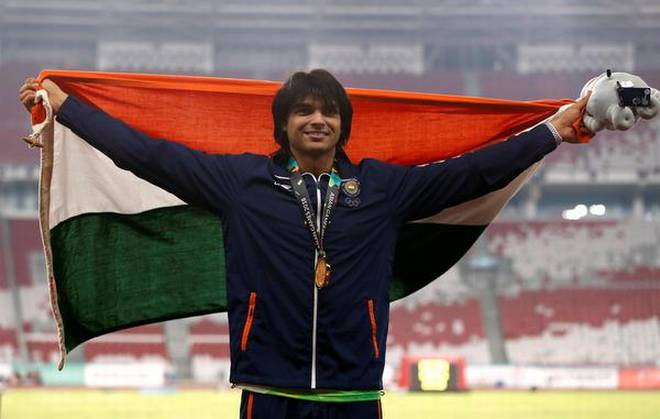 Neeraj Chopra with the tricolor after winning the Javelin gold at Asian Games 2018 | Twitter