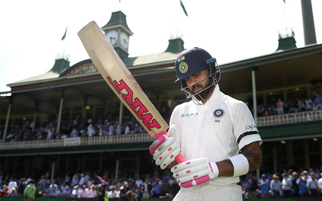Kohli walks out to bat at the SCG with pink bat grip and sticker | Getty