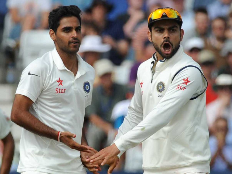 Bhuvneshwar Kumar with Virat Kohli | Source AP
