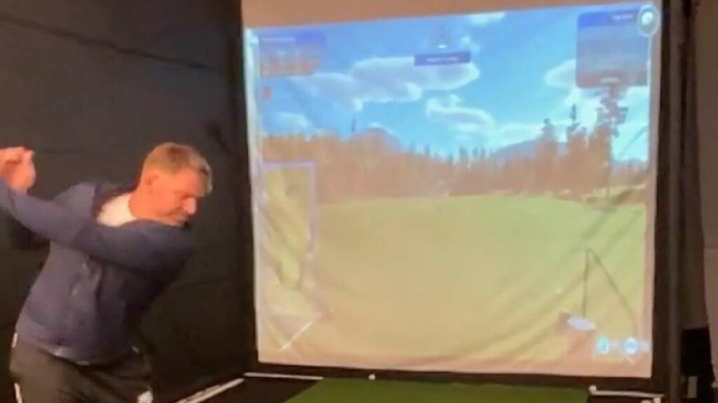 Shane Warne playing golf inside his Melbourne house