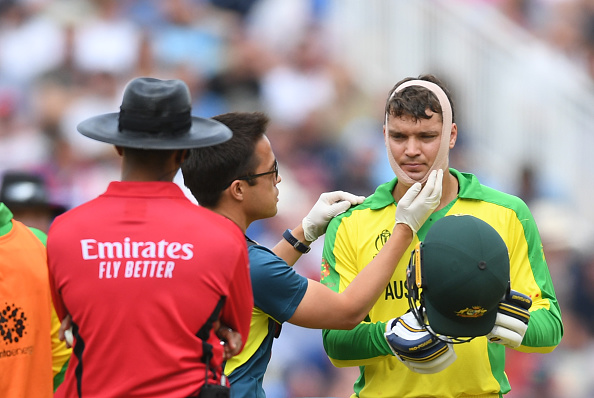 Carey gets his chin bandaged after been hit by Jofra Archer | Getty