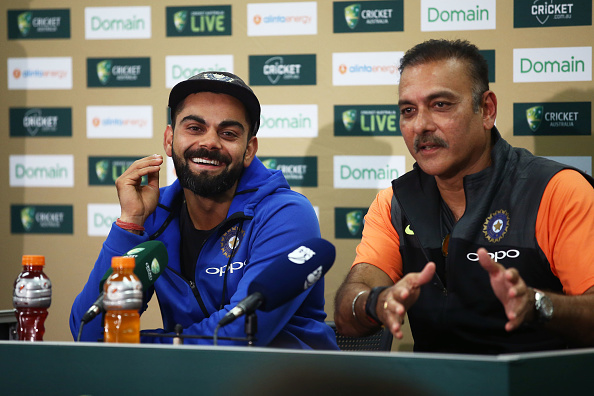 Indian captain Virat Kohli and head coach Ravi Shastri speak to the media after winning the Test series in Australia | Getty