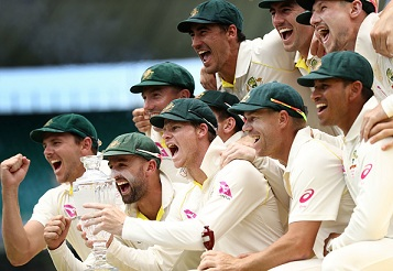 Australian team celebrating on the podium with the Ashes Trophy | Getty