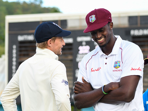 Joe Root and Jason Holder | Getty Images